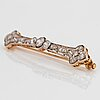 A platinum and 18k gold brooch set with old-cut diamonds with a total weight of ca 1.25 cts.