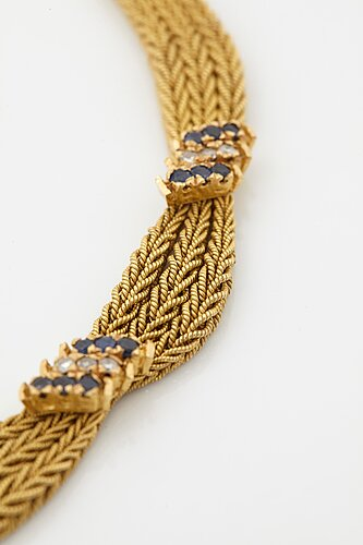 An 18k gold necklace set with eight-cut diamonds and sapphires.