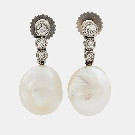 A pair of 18k white gold earrings set with pearls and round brilliant-cut diamonds.