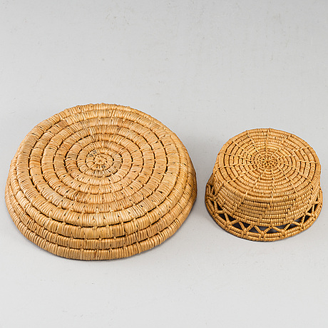 Two sami root baskets, one signed.