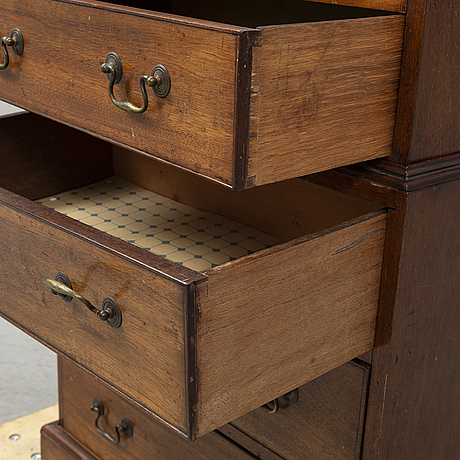 A mahogany 'tallboy' chest of drawers.