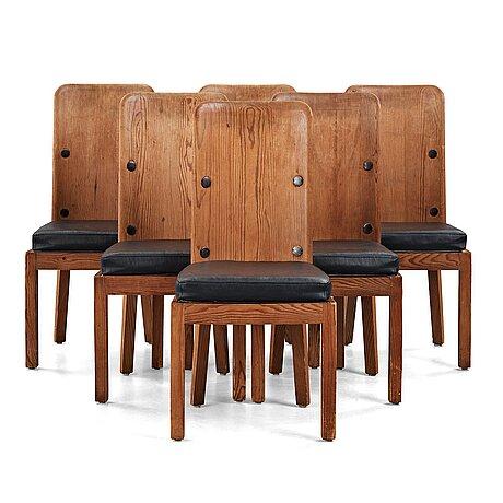 "Axel einar hjorth, a set of six high back ""lovö"" stained pine chairs, nordiska kompaniet, sweden 1930's."