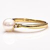 A 14k gold ring wirh diamonds ca 0.10 ct in total and a cultured pearl.