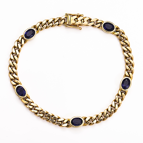 A 14k gold bracelet with cordierites.
