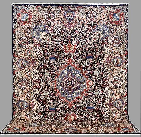 A carpet, figural kashmar, ca 395 x 300 cm.