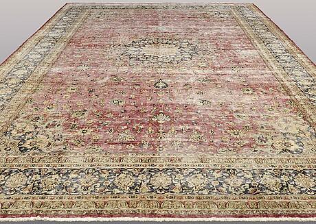 A carpet, oriental ca 608 x 388 cm.