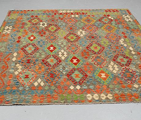 A carpet, kilim, ca 292 x 204 cm.