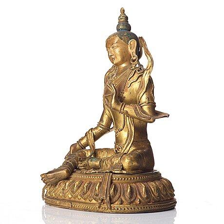 A gilt copper alloy figure of boddhisattva, tibeto-chinese, 18th century, marked da qing qianlong nian jingzao.