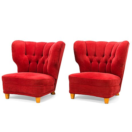 A pair of mid-20th century armchairs.