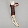 Per erik nilsson, a sami reindeerhorn knife, signed.