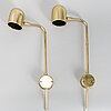 A pair of brass wall lights by bergboms.