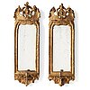 A pair of italien 18th/19th century one-light girandole mirrors.