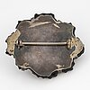 Carved possibly jet/coal and silver brooch.