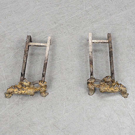 A pair of 19th century louis xv-style andirons.