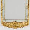 A rococo mirror by niclas meunier (1754-1797).
