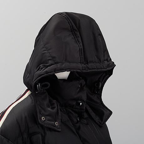 Gucci, a black polyamide down coat, italian size 42.