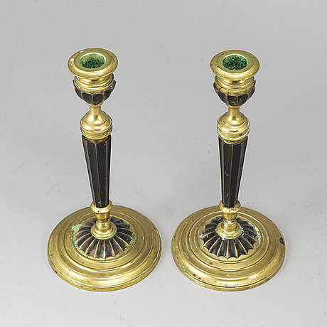 A pair of brass candlesticks, otto meyer, stockholm, ca 1900.