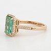 Emerald-cut emerald and brilliant-cut diamond ring.
