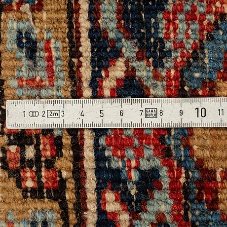 A carpet, semi-antique heriz, ca 278 x 202,5 cm.