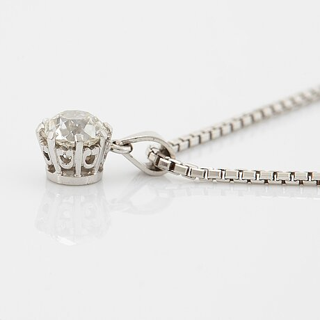 An 18k white gold pendant set with an old-cut diamond weight 1.44 cts according to engraving.