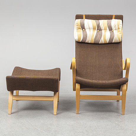 An easy chair and stool by bruno mathsson for karl mathsson, dated 1970.