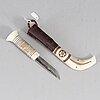 Jon ola utsi, a sami reindeer horn knife, signed jon o. utsi.