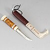 Tyko harald lampa, a sami reindeer horn knife, signed.