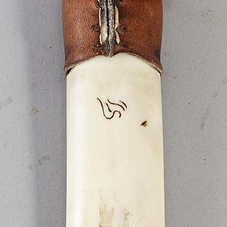 Lennart sammelin, a sami reindeer horn, signed.