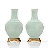 A pair of celadon vases with gilt bronze mounts, qing dynasty, 18th century.