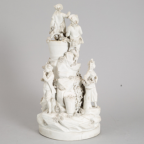 A biscuit porcelain figure group, circa 1900.