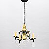 A ceiling light in glass and iron smithery by erik höglund. kosta boda from the second half of the 20th century.