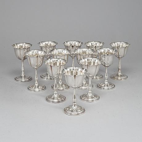A set of twelve 20th century sterling silver dessert-glasses.
