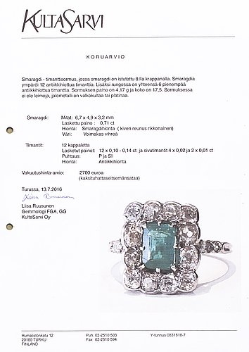 A platinum ring with an emerald ca 0.71 ct and old cut diamonds ca 1.66 ct in total.