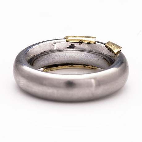 A steel and gold ring with a diamond ca. 0.015 ct.