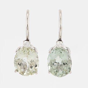 Light-green tourmaline and brilliant-cut diamond earrings.