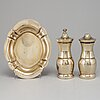 A pair of tiffany & co. silver-gilt sterling silver salt- and pepper grinder set.