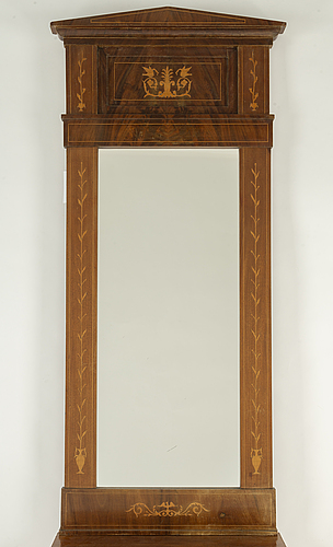 A mirror and cabinet from the mid 1800's.