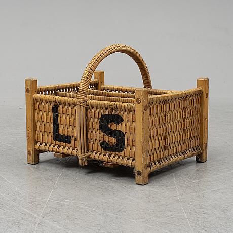 A rattan bottle basket.