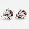 A pair of 18k white gold earrings with brilliant cut diamonds ca. 0.96 ct in total and rubies. rubens, helsinki.