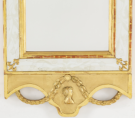 An empire style mirror, 20th century.
