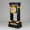 A french empire pendulum clock, first half of the 19th century.