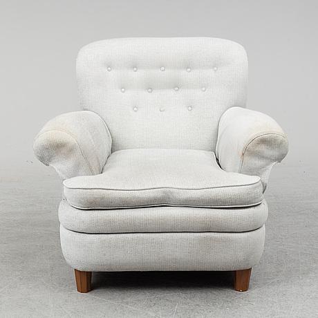 Josef frank, a model 568 easy chair from svenskt tenn.