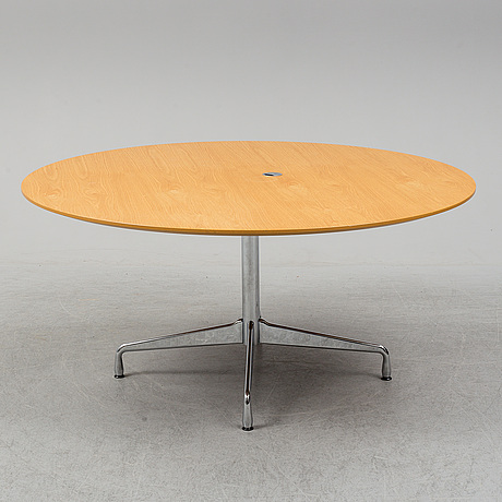 An office table by charles & ray eames for vitra.