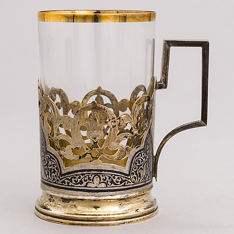 A russian silver teaglass holder and seven teaspoons, moscow and kiev, first half and mid-20th century.