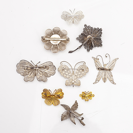 Nine silver brooches.