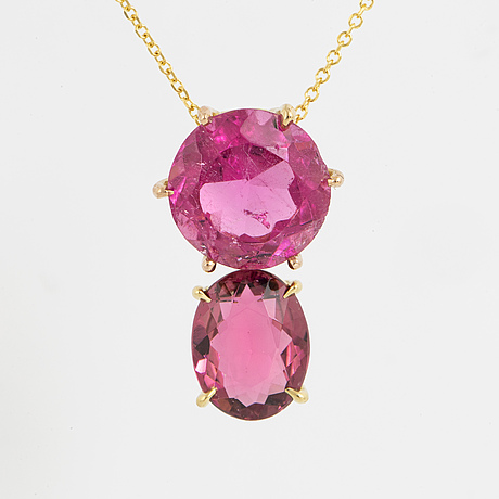 A 18k gold necklace with two pink facet cut tourmalines.