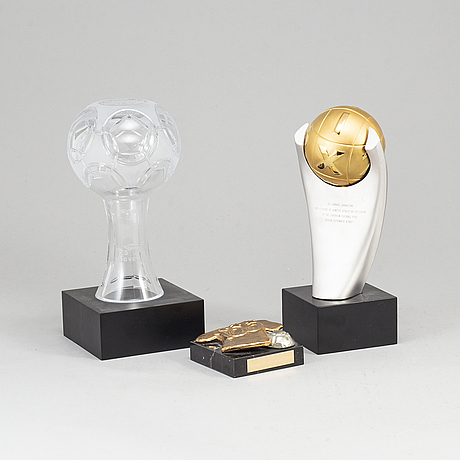 A collection of three soccer sculptures.