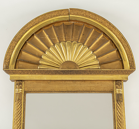 An empire mirror from the first half of the 19th century.