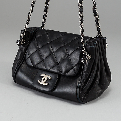 Chanel, a black leather bag, 2004-2005.