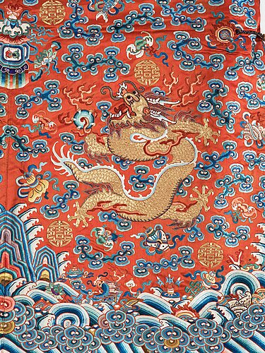 An embroidered silk robe, qing dynasty, 19th century.